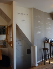 Taproom wall and stairs overview